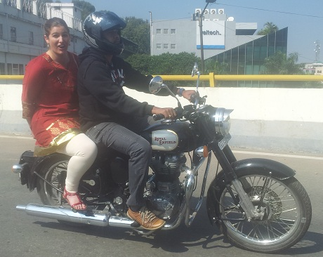 Natasha on the bike with Sunil